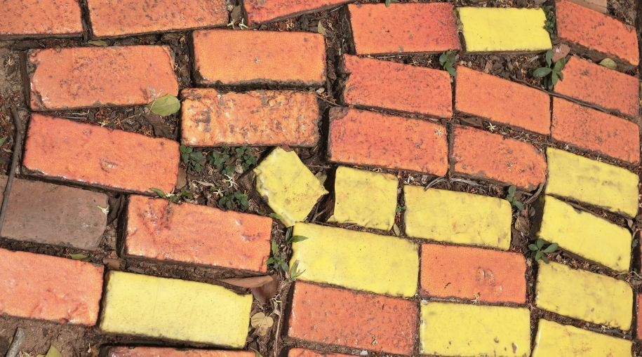 top view of bright yellow and orange bricks on the ground