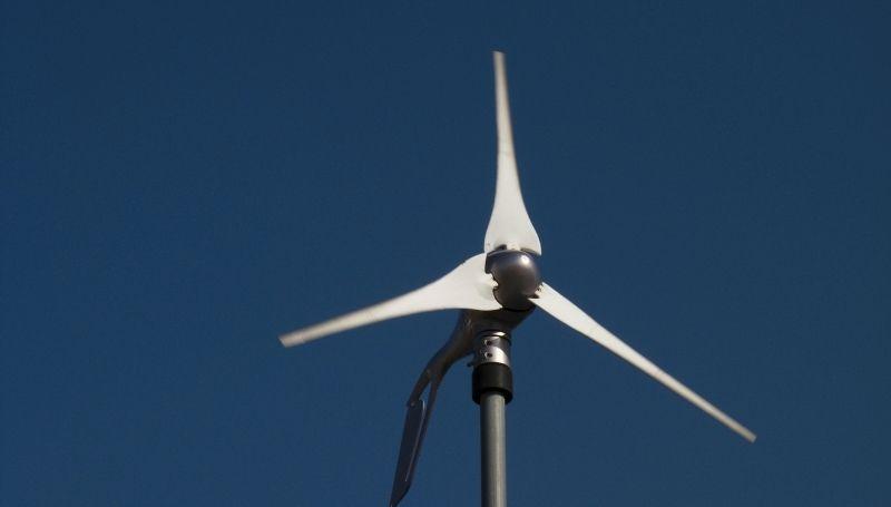 one white 3-blade home wind turbine