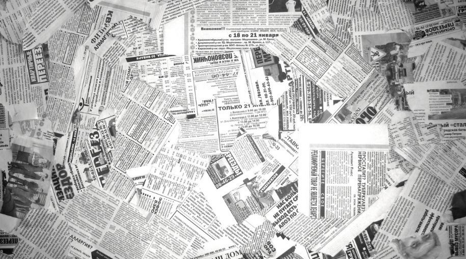 top view of scattered old newspapers pages