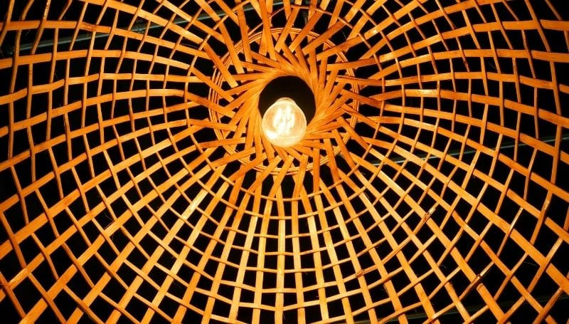 light fixture made of woven wood and a  warm bulb