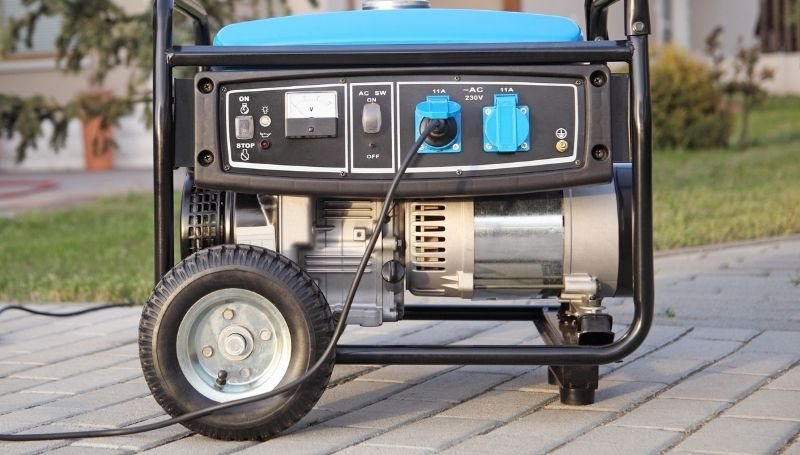 side view of a blue dual fuel generator showing different features