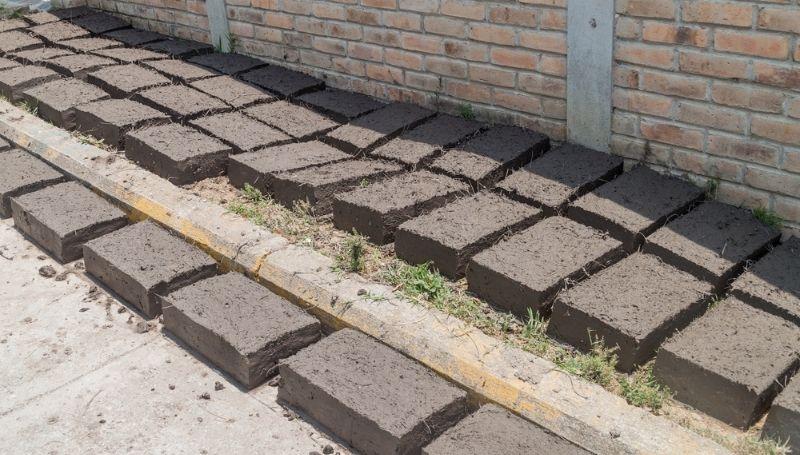 abobe bricks laid out on a pavement