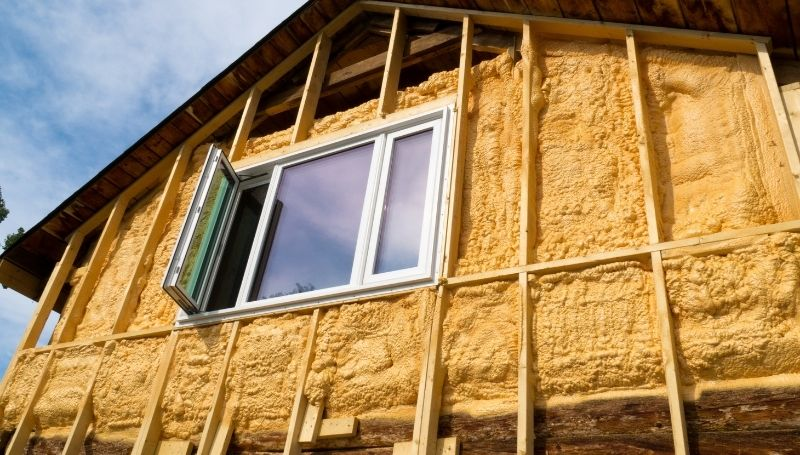 exposing an exterior wall with spray foam insulation