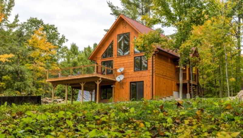 Log Cabin Kits from the Ultimate List of Affordable Green Prefab Homes