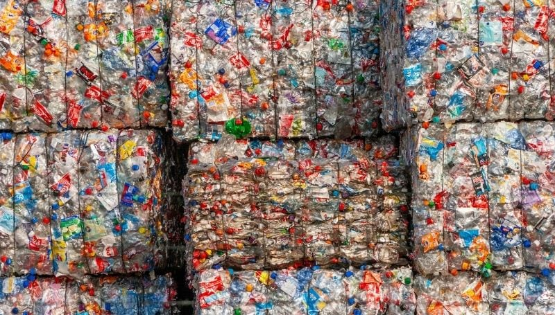 stacks of cleaned and flattened recycled plastic